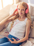 Teenage girl with gadget Stock Image
