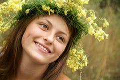 Teenage girl in garland Stock Photos