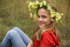 Teenage girl in garland Royalty Free Stock Image