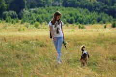 Teenage girl get fun at the farm with dog Stock Photo