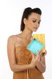 Teenage girl with the gift box Stock Image