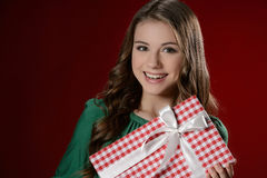 Teenage girl with gift box. Cheerful teenage girl holding a gift Royalty Free Stock Photography