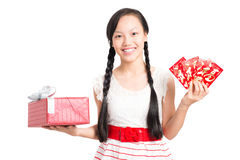 Teenage girl with gift and greetings Royalty Free Stock Photography