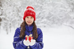 Teenage girl with a gift in their hands Stock Images
