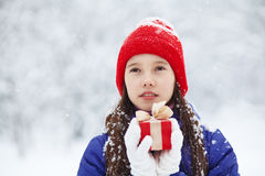 Teenage girl with a gift in their hands Stock Photo