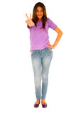 Teenage girl giving peace sign Royalty Free Stock Photography
