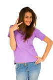 Teenage girl giving peace sign Stock Photos