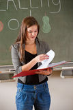 Teenage girl giving a presentation. In front of the classroom Stock Photo