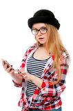 Teenage girl in glasses using cell phone Stock Photography