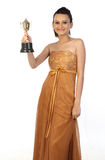 Teenage girl with gold trophy. Beautiful teenage girl with gold trophy royalty free stock photo
