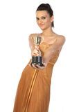 Teenage girl with gold trophy Royalty Free Stock Photography