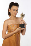 Teenage girl with gold trophy Royalty Free Stock Photo
