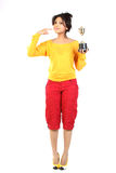 Teenage girl with gold trophy Stock Photos
