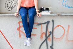 Teenage girl and graffiti Stock Photography