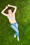 Teenage girl on grass Stock Images