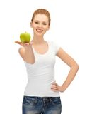 Teenage girl with green apple Royalty Free Stock Photography
