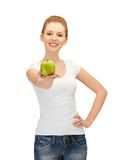 Teenage girl with green apple Royalty Free Stock Photos