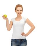 Teenage girl with green apple Stock Image
