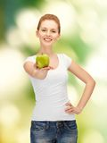 Teenage girl with green apple Royalty Free Stock Images