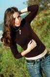 Teenage girl on the green background. Teenage girl with long hair on the green background Stock Photo