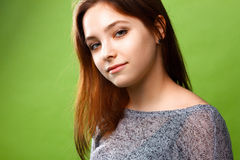 Teenage girl on green background Royalty Free Stock Photography