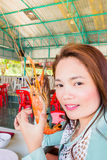 Teenage girl with grilled prawns, samui thailand Royalty Free Stock Photo