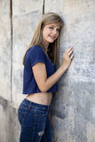 Teenage Girl with Grunge Wall Royalty Free Stock Photography