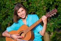 Teenage girl with guitar Royalty Free Stock Photography