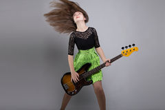 Teenage girl with guitar, shaked head Royalty Free Stock Image