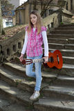Teenage Girl With Guitar Walking Down the Old Stone Stairs in the Park Royalty Free Stock Photos