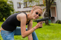 Teenage girl with gun Royalty Free Stock Photography