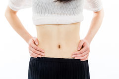 Teenage girl with hands on stomach closeup Stock Photo