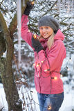 Teenage Girl Hanging Fairy Lights In Tree Royalty Free Stock Photos