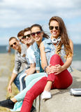 Teenage girl hanging out with friends outdoors Royalty Free Stock Images