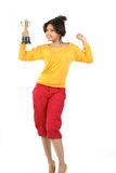 Teenage girl happy with the gold trophy. Teenage girl feeling happy with the gold trophy Stock Photo