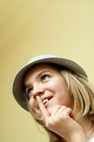 Teenage girl in hat. Portrait of a pretty young teenage girl wearing a hat and looking up thoughtfully Royalty Free Stock Photography