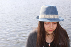 Teenage girl with a hat Royalty Free Stock Image