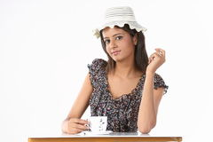 Teenage girl with hat having coffee Stock Photography
