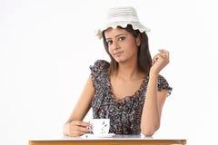 Teenage girl with hat having coffee Stock Photography