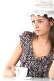 Teenage girl with hat having coffee Royalty Free Stock Photo