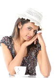 Teenage girl with hat having coffee Royalty Free Stock Images