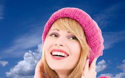 Teenage girl in hat over winter sky Royalty Free Stock Images