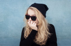 Teenage girl with hat sunglasses and attitude Stock Photos