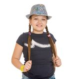 Teenage girl in a hat twitches his braids , close Stock Photography