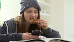 Teenage Girl Having Breakfast Whilst Sending Text Message stock video