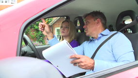 Teenage Girl Having Driving Lesson With Instructor stock video footage