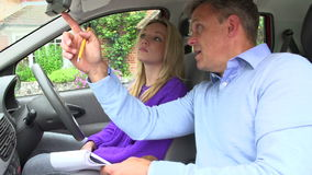Teenage Girl Having Driving Lesson With Instructor Stock Image