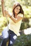 Teenage Girl Having Fun On Rope Swing Stock Photos