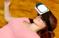 Teenage girl having fun with virtual reality using vr 3d headset Stock Image