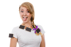 Teenage girl having little blackboards in hair Stock Image